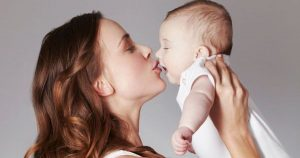 mother kissed baby with cold sore